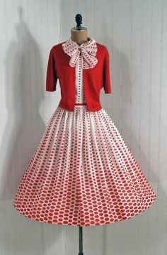 Sun Dress, A'Liglon: 1950's, polka-dot cotton print, matching over-sized bow-tie, wool bolero sweater, belt.