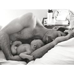 My sister took this picture of her husband napping with their week old son Elijah.