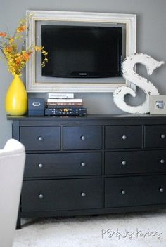 Frame around tv and large initial. (Perfect for an apartment bedroom!)