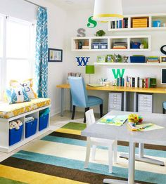 School room ideas. I really like the one desk top - It utilizes the space more efficiently and looks clean and simple.