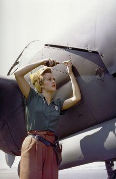A female Lockheed employee works on a P-38 Lighting. Burbank, CA - 1944