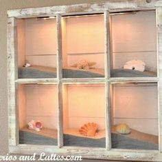This Old Window is reused to create shadow box look the drop lights really make this an outstanding feature perfect for any beach house