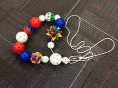 "Great for individuals who are blind or low vision...Put a variety of different textured balls on a large thin rope. Everyone sits/stands around the rope... with a ball in their hands. Play like Musical Chairs except move the balls around left to right or right to left. Play music. When the music stops, the one with the ""it"" ball either wins! (Decide ahead which ball is 'it'.)"