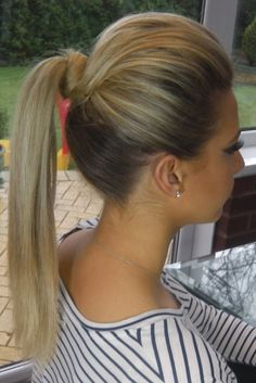 "I call this the ""Barbie Ponytail"". The knot lifting the pony & volume up top give your neck a longer appearance."