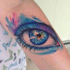 Beautiful eye tattoo with an abstract element to it