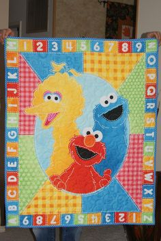 Big Bird, Cookie Monster and Elmo Panel Quilt. $36.00, via Etsy.- idea for panel quilt