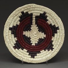 Coiled medicine or wedding basket made to hold sacred objects with the design representing the origin story of the Dine' (more commonly Navajo).
