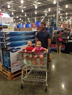 Sexy dad Tuc Watkins took his twins Catchen (Catch) and Curtis to Costco.  'My kids are 10 months old now which means they are crawling. Not only are they crawling – it's like they've got little jet packs on their backs and of course go in opposite directions.' 'They are animated, they are active, they're starting to talk in words that sound like syllables.'