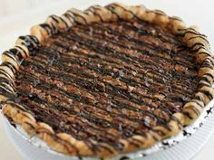 Hoosier Mama's Jeffersonville Pie | Serious Eats : Recipes Pecan pie with chocolate ganache topping. Made with Grade B maple syrup instead of corn syrup.