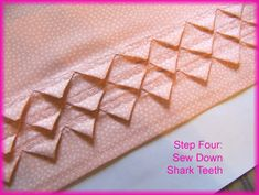 Sharks Teeth is a sewing technique that involves creating blind tucks in fabric, then snipping the tucks in intervals before folding in the raw edges created and sewing them in place