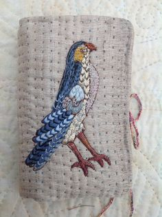 Front of my ,needle case.Bird design from Traquair 17th century canvas work.