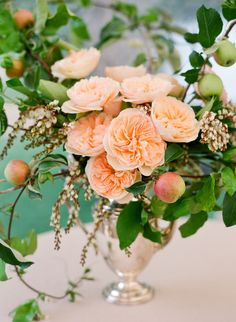 apples and apple branches from the property made their way into lush centerpieces, as did peach and white garden roses, passion vine, andromeda flowers, acorns, pears and dusty miller | floral design: Ariella Chezar