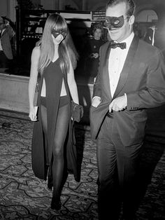Penelope Tree at a Masquerade Ball wearing a black cut out dress with black masquerade mask. #halloween #costume #style #fashion