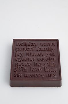 Solid chocolate block with words about the 'Spirit of Christmas'.