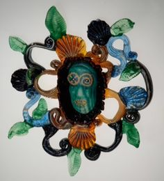 Teri Walker is amazing! All hand-blown glass. Reminiscent of Mardi Gras Indians. Very cool!