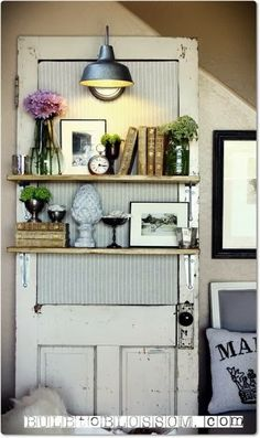 Salvaged door with shelves. The attached sconce is perfect.