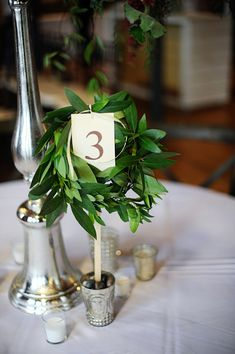 table number wrapped in greenery, photo by Kimberly Michelle Gibson Photography http://ruffledblog.com/notwedding-greenville #tablenumbers