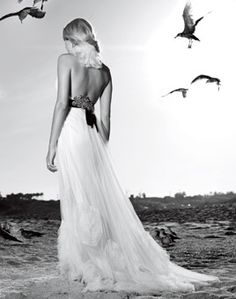 The dramatic details at the back of an ivory tulle halter gown by Vera Wang. Beachy Wedding Dresses. Photo: Warwick Saint.
