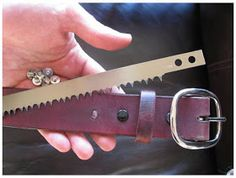 Leather Survival Belt with a bow saw blade inside.