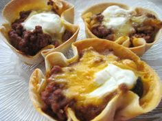 "Mini Taco Quiches from Food.com:   								Another recipe from the Simple 1-2-3 Easy Appetizers cookbook.  These tasty taco quiches are a party favorite.  The ""crust"" is a flour tortilla and the quiches are comprised of ground beef, taco seasoning, cheddar cheese, black olives, and sour cream."