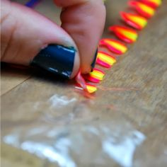 Ever wanted to paint pretty designs on your nails and then realized that it was impossible to do yourself because you have a dominant hand? Well here's a solution!!