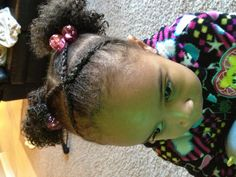 Crossing cornrow bangs w/Afro-puffs.  Toddler hair