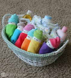 Making diaper babies for a baby shower are a cute and inexpensive gift idea! with washcloths from registry.