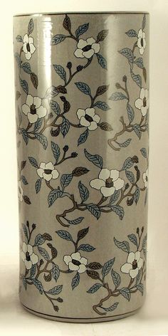 Grey & white floral umbrella stand.