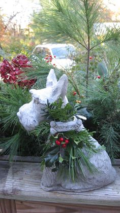 garden dog decorated for christmas