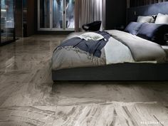 """The Rex line of interpretation in porcelain stoneware of the most precious natural materials is enriched with """"I Marmi"""". Have a look at this elegant bedroom thanks to the grey veined floor ceramic tile Marble Grey."""
