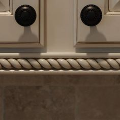 Under cabinet light rail molding with rope accents added to hide lighting and create visual interest