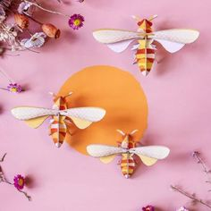 A set of three beautiful 3D honey bee wall decorations for the home, made from recycled cardboard and ready to hang. This wonderful set of brightly coloured honey bee wall decorations comes flatpacked and ready to build in minutes, with no glue needed and no DIY skills required! Bring the outside inside with these fabulous hanging insects - use to adorn any walls in the house, from kids rooms to kitchens, conservatories and hallways. The pack consists of three different sized cardboard bees, eac