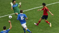 Cesc Fàbregas (R) of Spain scores their first goal during their UEFA EURO 2012 Group C match against Italy