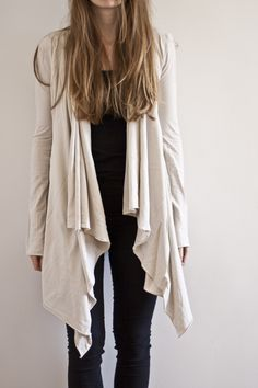DIY: asymmetrical wrap cardigandirections here: http://diymaternity.com/outerwear/how-to-make-a-wrap-cardigan/