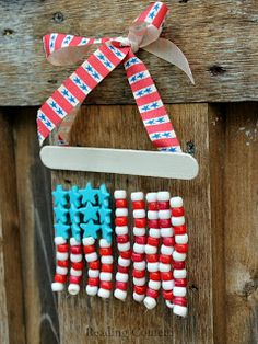 American Flag Magnet: Winter Olympic Crafts for Kids. Let your favorite flag reign on the fridge! #StayCurious summer time crafts for kids, bead crafts for kids, pony beads, crafts flag american kids, 4th of july crafts for kids, american flag crafts for kids, the craft, olympic crafts, poni bead