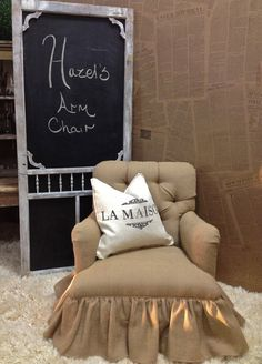 Love the idea of making a chalkboard out of an old screen door.  Lovely upholstery, too!!  Cozy.