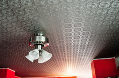 Paintable wallpaper and metallic paint looks like old tin. I have a roll of this. Stove backsplash project in 3...2...