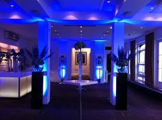 The Foyer Bar - Blue Uplighters and flowers