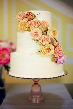 Wedding cake with fresh garden roses | Austin Gros | Brides.com