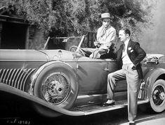 William Powell admiring Gary Cooper's Duesenberg