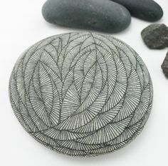 drawing onto a stone zentangle