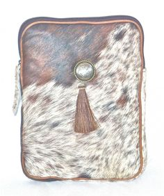 """Cofi Case - Tablet/eBook CoFi Case - Dakota, $119.99 (http://store.coficase.com/tablet-ebook-cofi-case-dakota/); Hair-on Cowhide Tablet Case with Horsehair Tassel, protects your iPad, Kindle Fire HD 8.9"""", and more!"""