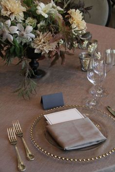 Elegant tablesetting and centerpiece with subdued palette