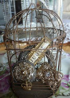 Fill a birdcage with pretty things....