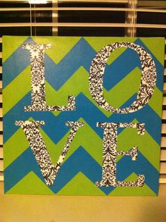 chevron painted canvas with scrapbook paper letters mod podge'ed on!