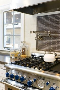 Spoil yourself with a potfiller above your range or cooktop. #Thermador Professional Series Range and #Rohl Potfiller