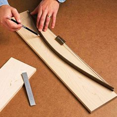 Fairing Stick    A thin strip of wood and a piece of nylon Mason's cord are all it takes to create this arc marking aid.