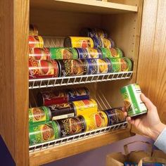 Use wire closet racks in kitchen cabinets for easy can storage.
