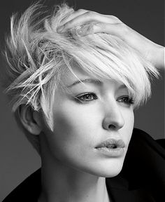 A short blonde straight coloured messy spikey hairstyle by Jean Louis David