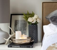 the perfect bedside arrangement. love the candles in an antique silver bowl